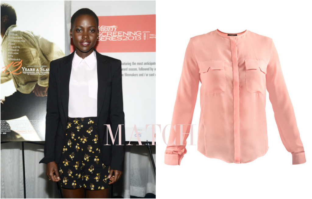 Lupita wears smart shirt with pocket flap similar to the Kitty Dolly shirt