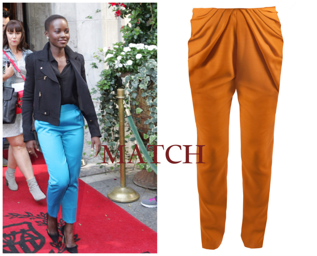 Lupita in tailored casual smart trousers similar to the Kitty Zephaniah trousers